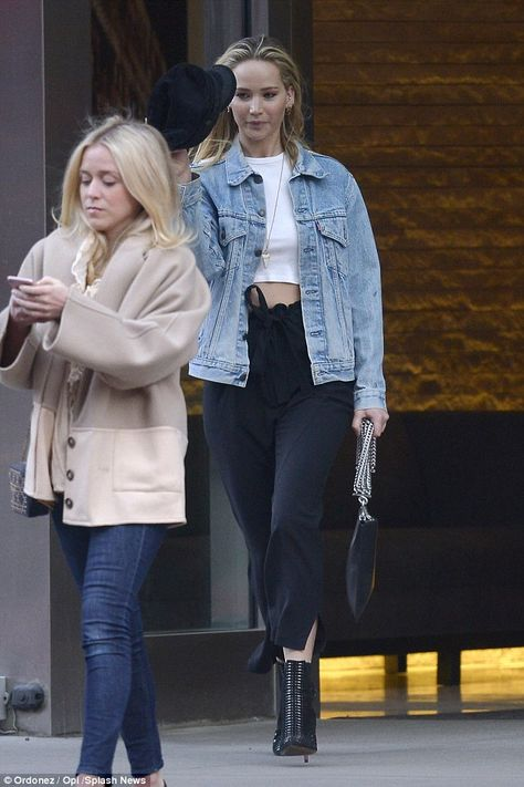 Out and about: She kept her makeup to a minimum and accessorized with a large black purse ... #jenniferlawrence