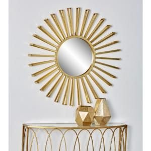 This Modern Wall Mirror Highlights A Radiating Sun Design That Would Make Your Wall An Eye Catching Focal Poin Mirror Wall Mirror Wall Decor Modern Mirror Wall