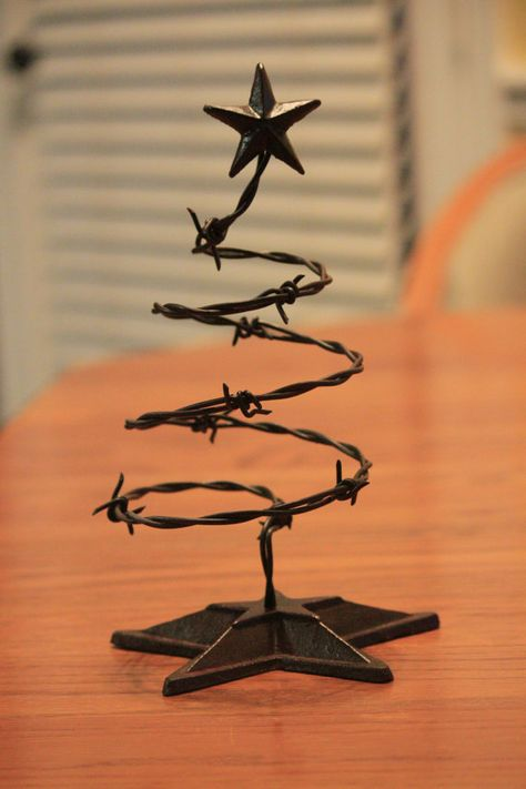 Items similar to Barbed Wire Christmas Tree on Etsy Hey, I found this really awesome Etsy listing at Cowboy Christmas, Primitive Christmas, Country Christmas, Metal Christmas Tree, Horseshoe Christmas Tree, Charlie Brown Christmas Tree, Primitive Fall, Primitive Crafts, Xmas Crafts