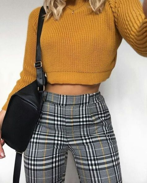 Take a look at these classic black and white gingham trousers with an added flare of mustard yellow! #trousers #gingham #ginghamtrousers #fashion #pants