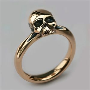 Beautifully crafted small solid 9ct and 18ct yellow gold Skull ring handmade by quality skull jewellery designer Stephen Einhorn London. Shop his unique edgy collection online or instore.
