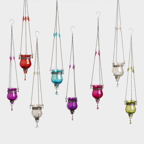 Glass Dahlia Hanging Tealight Lanterns Set of 8 ---- Embellished with a delicate metal frame and small glass beaded details, our vibrant hanging lanterns cast a vividly hued glow through colored glass while holding a tealight safely inside. Lantern Set, Led Lantern, Hanging Candles, Hanging Tea Lights, String Lights, Lanterns Decor, Glass Lanterns, Patio Lighting, Estilo Boho