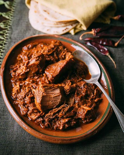 Our testers were smitten with this smoky, spicy, and sweet pork in chile sauce that is a cinch to make. Promise. #porkshoulder #porkrecipes #mexican #chilesauce