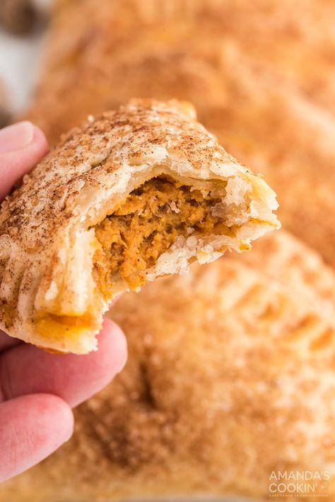 Welcome fall with these adorable pumpkin hand pies! The pumpkin spice filling has only four ingredients so they're quick and easy to make! #pumpkin #pumpkinrecipe #pumpkinhandpie #fallfood #fallrecipe #halloweenrecipe #thanksgiving #thanksgivingrecipe #fouringredients #amandascookin