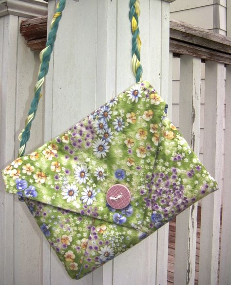 Origami Purse- This is a pattern for a workshop I took. I love this pattern. I bought 1 yard each of contrasting fabric. These would make easy Christmas gifts.