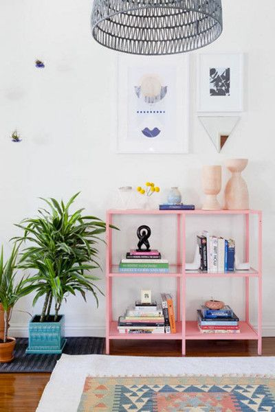 Rosy Bookshelf - 15 Rooms That Make The Case For Decorating With Pink - Photos