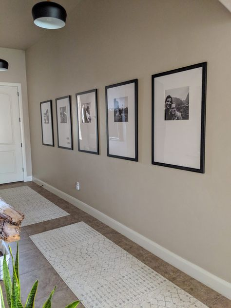 Long Entryway Ideas - Our Entry Hallway Before/After - The DIY Lighthouse - - Modern, boho hallway and long entryway ideas. Our entry hallway makeover including pendant lighting, coat hangers, live edge shelf and large travel gallery. Hallway Wall Decor, Hallway Walls, Entryway Decor, Entryway Ideas, Hallway Decorations, Flat Hallway Ideas, Hall Way Decor, Dark Hallway, Rustic Entryway