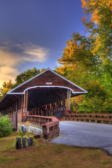 Rowell's Covered Bridge in West Hopkinton, New Hampshire, which carries Clement Hill Road over the Contoocook River. The Long truss bridge was completed in 1853, and was the third bridge on the site.