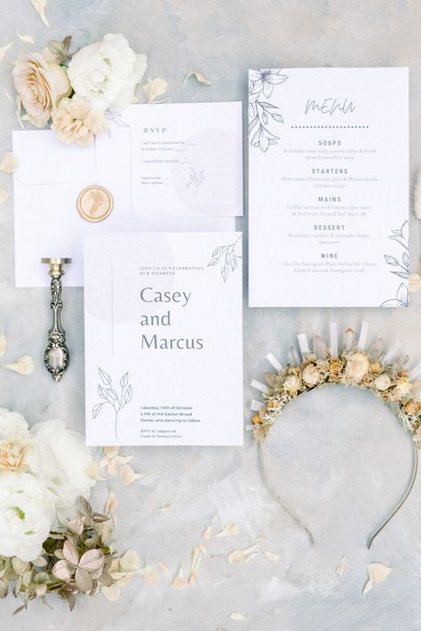 From the editorial An Empowering Editorial at Easton Broad Inspired by Butterflies. An epic invitation suite, a romantic bridal headband, and soft blooms to bring it all together. This flat lay is as dreamy as it gets. Styling  Photography: @rtfaithphotography #weddinginvitation #invitationsuite #weddingstyling #flatlay #weddingdetails
