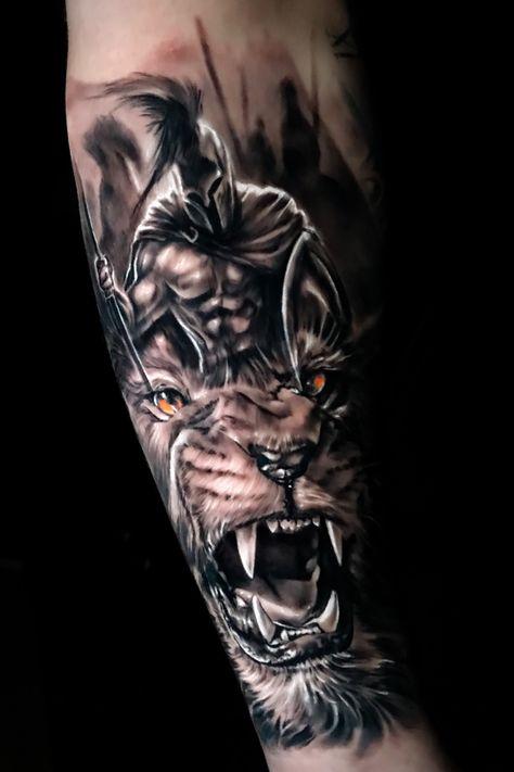 Black & gray realism lion and warrior soldier spartan Warrior Tattoo Sleeve, Forest Tattoo Sleeve, Tiger Tattoo Sleeve, Lion Tattoo Sleeves, Armor Tattoo, Warrior Tattoos, Best Sleeve Tattoos, Best Arm Tattoos, Mountain Sleeve Tattoo