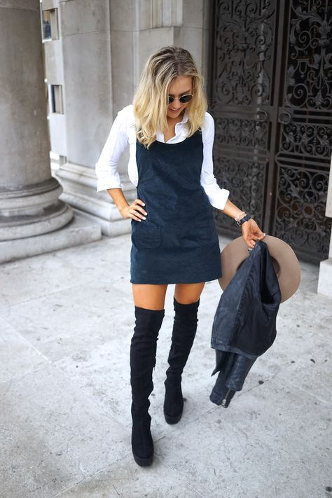 Knee high boots and a pinafore dress