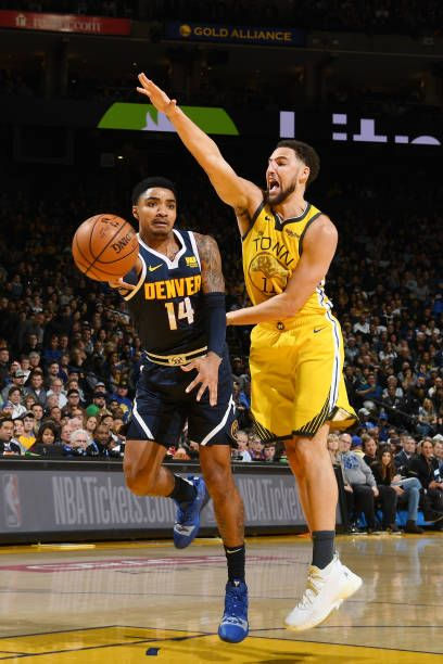 Gary Harris Of The Denver Nuggets Passes The Ball Against The Golden Denver Nuggets Denver Nba Uniforms