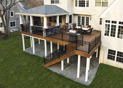 This custom deck and porch showcases TimberTech walnut evolutions decking. The main feature of the deck is the gas fireplace under the porch. The ceiling Modern Koi, Modern Deck, Modern Design, Patio Grande, Porch Kits, Building A Porch, Building Plans, Backyard Patio Designs, Patio Ideas