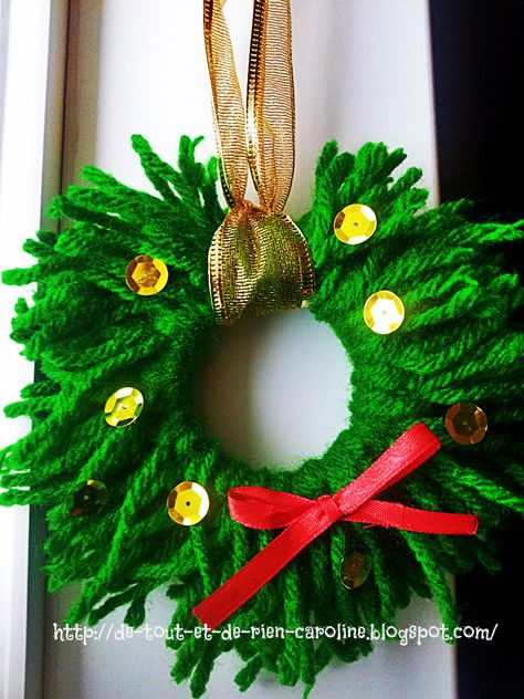Simple Christmas wreath made with yarn. Beautiful frugal ornament for your Xmas tree! No instructions but could use a key ring to tie the yarn onto.