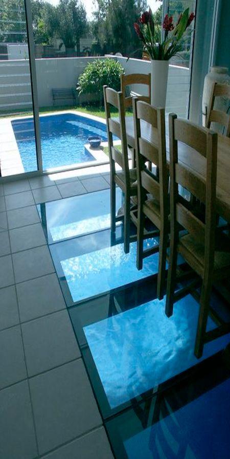Australian pool company glass floor dining room over the pool