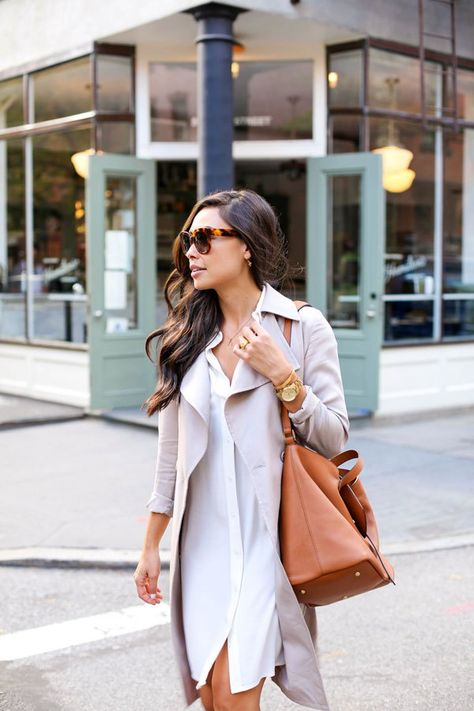 Kat Tanita of With Love From Kat wears an easy draped trench coat in West Village, NYC.