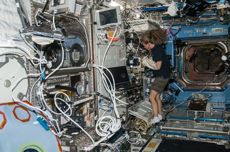 Karen Nyberg, Expedition 36 flight engineer, works with new test samples for the Advanced Colloids Experiment, or ACE, housed inside the Microgravity Science Glovebox of the International Space Station's Destiny laboratory. Results from ACE will help researchers understand how to optimize stabilizers to extend the shelf life of products like laundry detergent, paint, ketchup and even salad dressing.