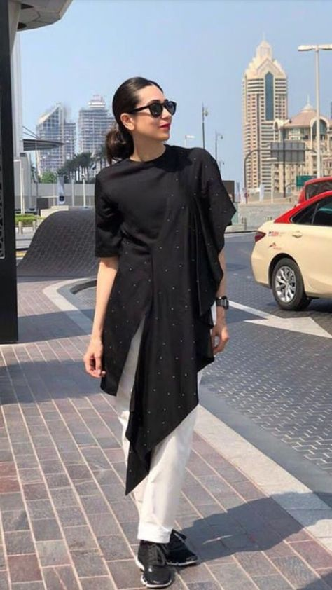 Karishma Kapoor In Beautiful Asymetric Tunic With White Pant And Black Sunglasses , She Complete The Looks With Black Loafer Shoes