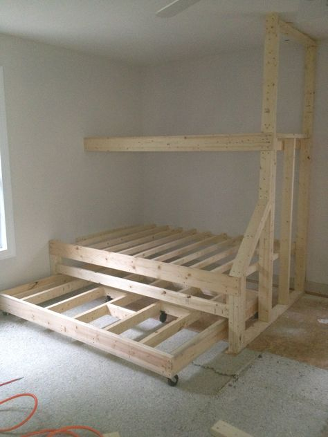Built in bunk beds with trundle bed. Gives plenty of sleeping spaces without taking up too much room. Image only