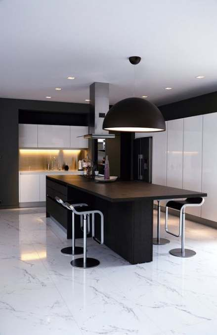 Black And White Kitchen Features Black Shaker Cabinets Paired With White Marble Countertops And A Shaker Kitchen Cabinets Black Kitchen Cabinets Kitchen Marble