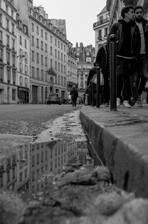 Montparnasse, Paris, France, February 2018.First quality Print of numerical photography. Direct print on Aluminium 3mm, 50x75 cm. Highly strong, rigid, waterproof and finest no pixelized result. Winter 2018 was particularly cold in Paris, where it does not necessarily snow every year. There, it was the case, in quantity, allowing me magnificent shots of reflections on the ground, like here. A way to highlight urban life, with a different look, from a point of view allowing to show this incredibl