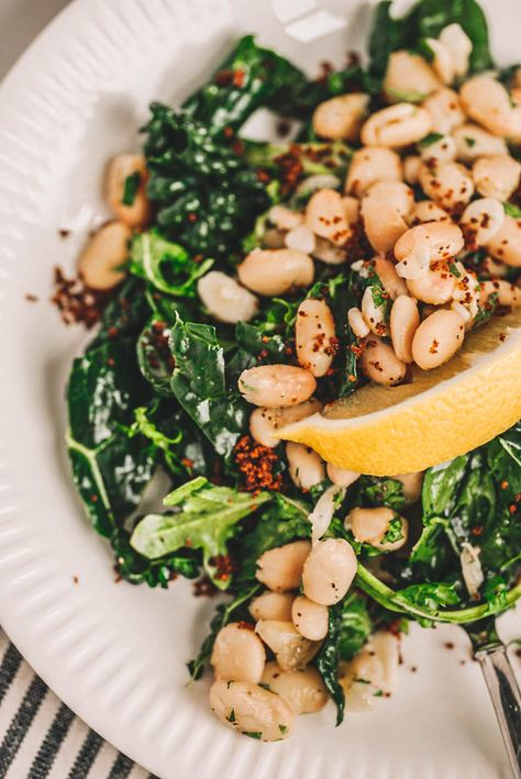 This White Bean & Kale Salad Recipe will have you craving kale! Made with kale, white beans, toasted bread crumbs, and the best lemon tahini dressing. #kalesalad #saladrecipe #whitebeansalad #kale #healthyrecipes #vegan #vegetarian