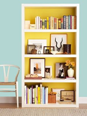"""painted bookcase I have a corner shelf that is painted the same way.  The yellow makes the colors of the items on the shelf """"pop"""""""