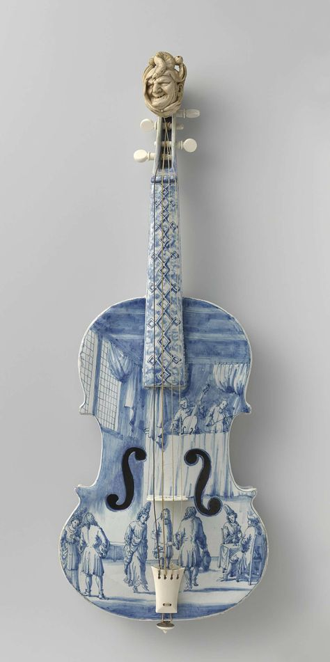 Delftware violin, ca. 1705 - ca. 1710.  It is unplayable but beautiful.  Note the jester head!