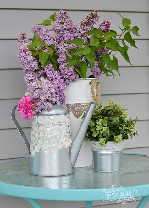 Embellish garden planters and watering cans with lace and Mod Podge