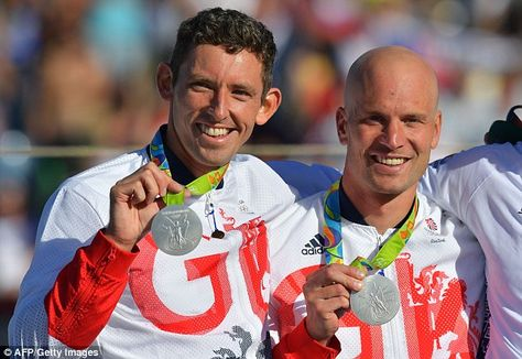 British heroes:David Florence and Richard Hounslow celebrate with their silver medals on the podium