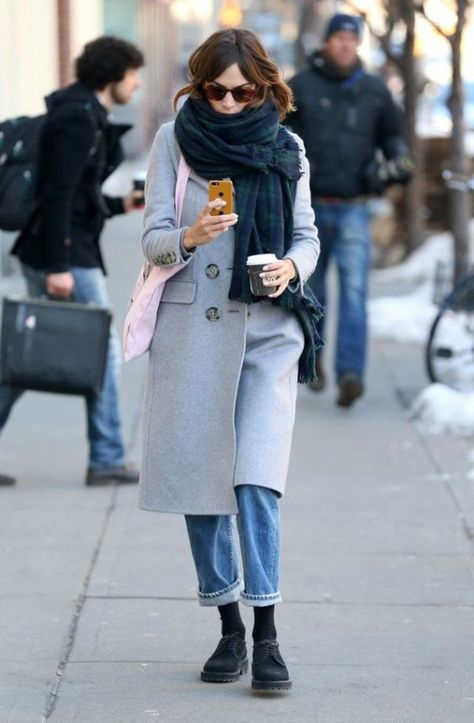 Alexa Chung wrapped up in NYC in boyfriend jeans, oversized scarf and doc martins.