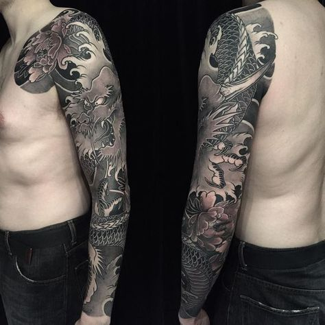 Finished this black and grey dragon and peony sleeve. There's something about finding the rhythm of an all black and grey piece. It's like a great song. #japanesecollective #japanesetattoo #irezumi #ryu #peonytattoo #botan #tattoo by levioner