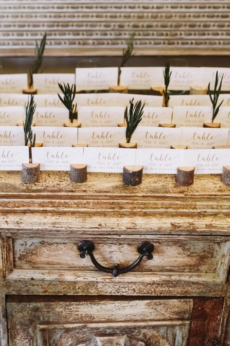 Nature-themed escort cards for a fall wedding in New Jersey | Photo: Sanford Creative