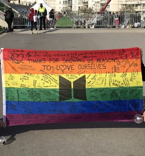 Here's The Heartwarming Tale Behind The LGBT Pride Flag At A BTS Concert That Went Viral