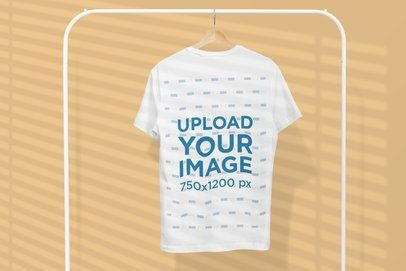 Download Placeit Mockup Of A T Shirt Hanging Alone From A Rack Clothing Mockup Mockup Design Mockup Template