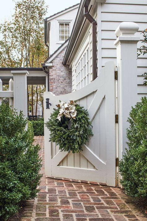 Something about a swinging outdoor gate that makes a home classic but inviting Interior designer Jane Schwab decks the halls of her classic Charlotte, North Carolina, home to create celebration-worthy spaces that are as inviting as they are elegant Tor Design, Gate Design, House Design, Design Homes, Design Design, Garage House, Outdoor Spaces, Outdoor Living, Outdoor Decor