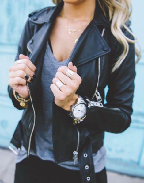 grey t-shirt & leather jacket.