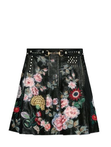Shop the Hand-painted leather skirt by Gucci. A pleated leather skirt with a Horsebit buckle detail is further enchanced with hand-painted flowers, the painted flowers are mixed in with hand-embroidered floral designs and studded detail.