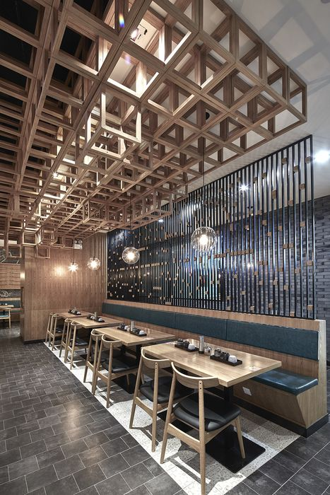 A canopy of wooden cubes provides a dynamic setting for diners at Dacong's Noodle House, a casual eatery in Shanghai by the Swimming Pool…