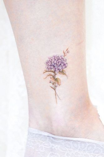 23 Flower Tattoos Designs And Meanings For Your Inspo Hydrangea Tattoo Flower Tattoos Small Watercolor Tattoo