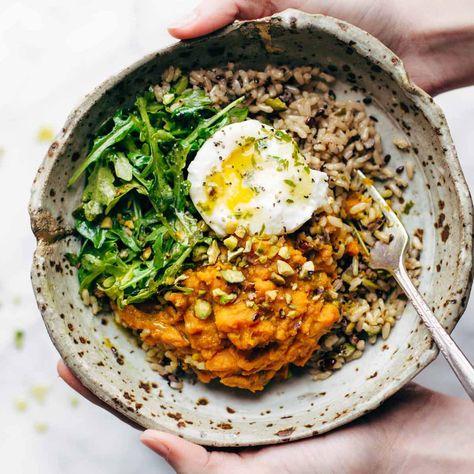 Healing Bowls: turmeric sweet potatoes, brown rice, red quinoa, arugula, poached egg, lemon dressing. #vegetarian #sugarfree #glutenfree #healthy #recipe | pinchofyum.com