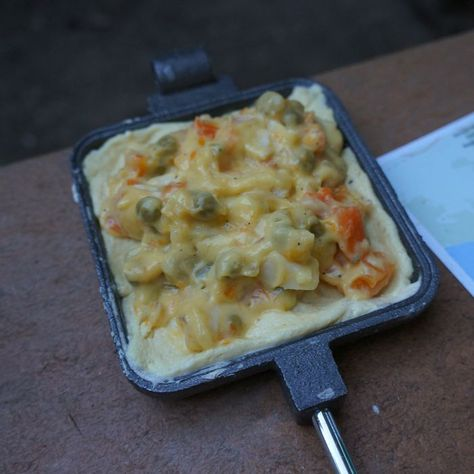 An amazing camping pie iron recipe! Is there anything better than Chicken Pot Pie around the campfire?