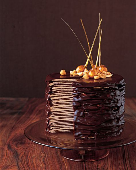 Dark chocolate crepe cake. This is a decadent dessert at one of my favorite Italian restaurants. While savoring a big forkful recently, I said I couldn't imagine what a pain in the keister it'd be to make this thing! But now that I've stumbled on a recipe, I might have to give it a go...