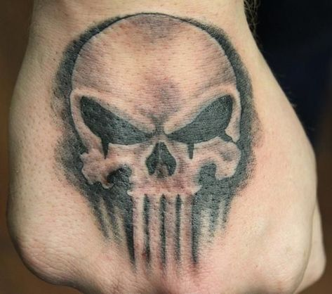 What does punisher tattoo mean? We have punisher tattoo ideas, designs, symbolism and we explain the meaning behind the tattoo.