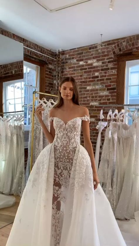Our Athena wedding dress from the Fields of Pearls collection is an off the shoulder mermaid gown featuring beaded lace appliqués sheer skirt, and dramatic detachable overskirt, plus detachable puffy tulle sleeves with floral details. #LeeGrebenau #LeePetraGrebenau #CoutureBridal #fall2020collection  #LuxuryBridal #MadeToMeasureBridal #MadeToMeasure #BespokeBridal #weddings #weddinginspiration #Fall2020Bridal #2020BridalTrends