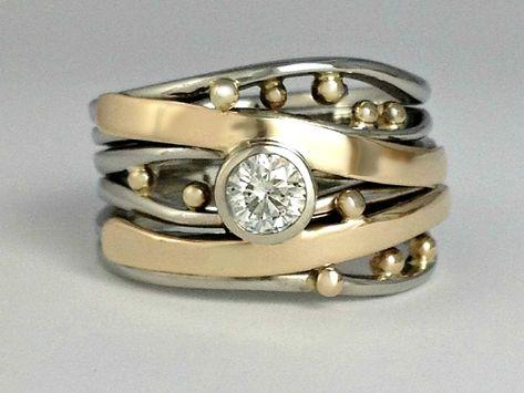 Bubbles & Wake Ocean inspired romance Ring with a bezel set Diamond.