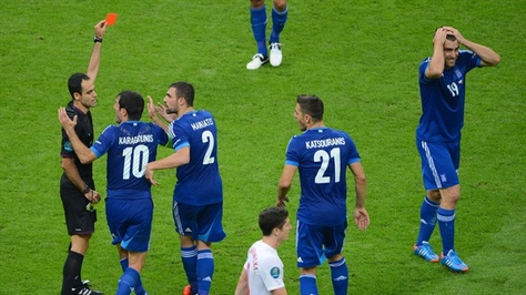 #euro2012 #redcard - Referee Carlos Velasco #Carballo shows Sokratis #Papastathopoulos (right) of Greece a red card just before half-time
