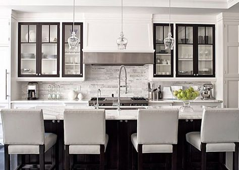 White cabinets with black doors with glass