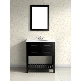 """Add classic style to your master bath or powder room with this vanity. Showcasing a lacquer-finished wood base, and white countertop, this eye-catching design adds timeless elegance to your decor.  Product: Bathroom vanityConstruction Material: HardwoodColor: Black and whiteFeatures:  Two functional drawersOne bottom shelfThree pre-drilled faucet holes for standard 4"""" center faucet 105 Degree hidden hingesDimensions: 35"""" H x 30"""" W x 21"""" DNote: Faucet and mirror not included"""