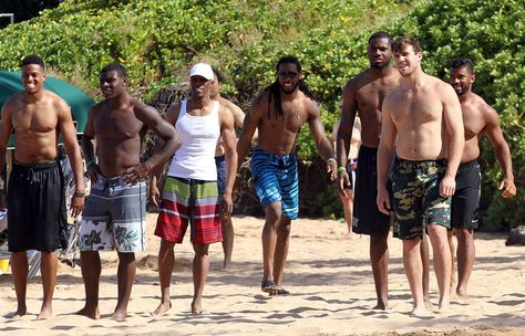 A slew of Seattle Seahawks players shirtless on the beach (Via POPSUGAR; source: FameFlynet)